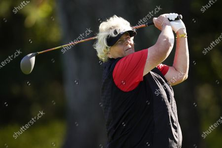 Stock Picture of Laura Davies, of England,Lindy Duncan watches her tee shot on the 13th hole during the first round of the KPMG Women's PGA Championship golf tournament at the Aronimink Golf Club, in Newtown Square, Pa