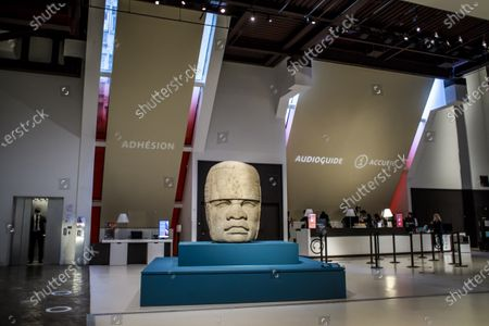 A view of the colossal Olmec head 'Monument 4' of San Lorenzo (1,200-900 BC) during a press preview of the exhibition 'The Olmecs and the Civilizations from the Gulf of Mexico' at the Quai Branly Museum-Jacques Chirac, a museum featuring indigenous art and cultures of Africa, Asia, Oceania and the Americas, in Paris, France, 08 October 2020. The exhibition opens to the public on 09 October 2020 to 25 July 2021.