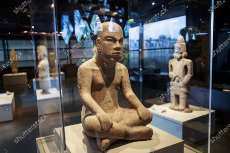 A male sculpture on display during a press preview of the exhibition 'The Olmecs and the Civilizations from the Gulf of Mexico' at the Quai Branly Museum-Jacques Chirac, a museum featuring indigenous art and cultures of Africa, Asia, Oceania and the Americas, in Paris, France, 08 October 2020. The exhibition opens to the public on 09 October 2020 to 25 July 2021.
