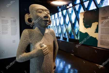 Stock Image of 'L'Adolescent', a male sculpture on display during a press preview of the exhibition 'The Olmecs and the Civilizations from the Gulf of Mexico' at the Quai Branly Museum-Jacques Chirac, a museum featuring indigenous art and cultures of Africa, Asia, Oceania and the Americas, in Paris, France, 08 October 2020. The exhibition opens to the public on 09 October 2020 to 25 July 2021.