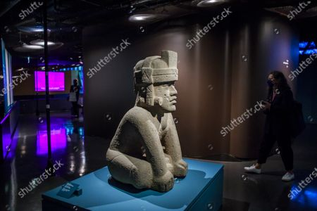 A seated deity sculpture on display during a press preview of the exhibition 'The Olmecs and the Civilizations from the Gulf of Mexico' at the Quai Branly Museum-Jacques Chirac, a museum featuring indigenous art and cultures of Africa, Asia, Oceania and the Americas, in Paris, France, 08 October 2020. The exhibition opens to the public on 09 October 2020 to 25 July 2021.