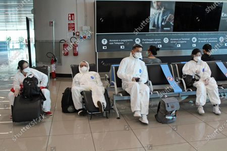 Passengers in transit area at 'Leonardo da Vinci' airport, in Fiumicino, near Rome, Italy, 08 October 2020. Due to the increased demand for rapid Covid-19 antigenic tests, the health authorities of the Lazio Region decided to build in an additional rapid covid-19 test center at the parking lot Long Stop of the airport 'Leonardo da Vinci' in Fiumicino at an area of about 7000 meters and equipped with six sanitary check-points for sampling and able to accommodate up to 130 cars.