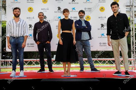 Javier Ruiz Caldera (2-L) and Alberto del Toro (4-L), and Spanish actors Miki Esparbe (R), Aura Garrido (C) and Dafnis Balduz (L) pose for photographers during the presentation of their movie 'Malnazidos' on the opening day of the 53rd Sitges International Fantastic Film Festival of Catalonia, in Sitges, Spain, 08 October 2020. The festival runs from 08 October to 18 October 2020.
