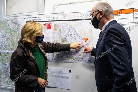 German Minister of Food and Agriculture Julia Kloeckner (L) and Premier of Brandenburg Dietmar Woidke (R) look at a map during a the state crisis team meeting to combat the African Swine Fever (ASF) in Eisenhuettenstadt, Brandenburg, Germany, 08 October 2020. Soldiers from the Jaeger Battalion 413 and the Brandenburg Reserve Support Company are currently deployed to combat the African Swine Fever (ASF).