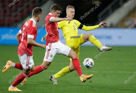 Sweden's Viktor Claesson, right, and Russia's Roman Zobnin challenge for the ball during the international friendly soccer match between Russia and Sweden at CSKA Arena in Moscow, Russia