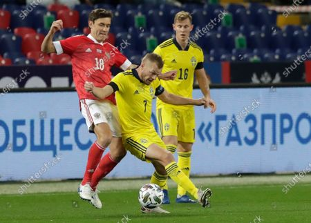 Russia's Aleksandr Zhirov, left, and Sweden's Sebastian Larsson challenge for the ball during the international friendly soccer match between Russia and Sweden at CSKA Arena in Moscow, Russia