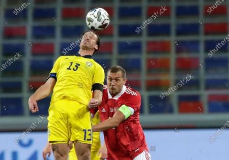Sweden's Gustav Svensson, left, and Russia's Artem Dzyuba challenge for the ball during the international friendly soccer match between Russia and Sweden at CSKA Arena in Moscow, Russia