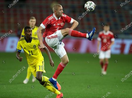 Stock Image of Russia's Yuri Gazinskiy kicks the ball ahead of Sweden's Alexander Isak, left, during the international friendly soccer match between Russia and Sweden at CSKA Arena in Moscow, Russia