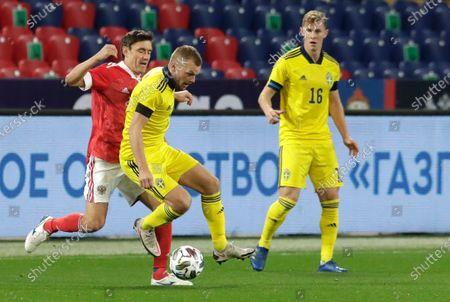 Russia's Aleksandr Zhirkov, left, and Sweden's Sebastian Larsson challenge for the ball during the international friendly soccer match between Russia and Sweden at CSKA Arena in Moscow, Russia