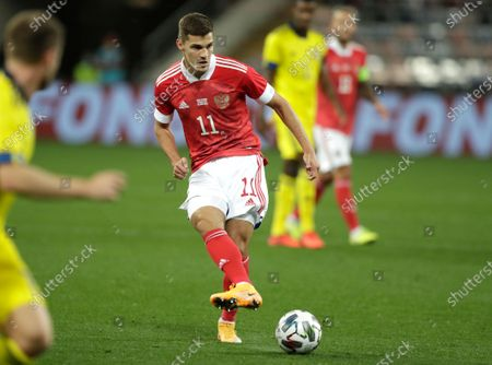 Russia's Roman Zobnin controls the ball during the international friendly soccer match between Russia and Sweden at CSKA Arena in Moscow, Russia