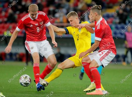 Stock Photo of Mattias Svanberg (C) of Sweden in action against  Yuri Gazinski (L) and Ilya Kutepov (R) of Russia during the international friendly soccer match between Russia and Sweden at VTB Arena in Moscow, Russia, 08 October 2020.