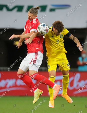 Jordan Larsson (R) of Sweden in action against Ilya Kutepov (L) of Russia during the international friendly soccer match between Russia and Sweden at VTB Arena in Moscow, Russia, 08 October 2020.
