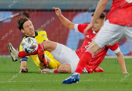 Gustav Svensson (L) of Sweden in action against Andrei Mostovoy (R) of Russia during the international friendly soccer match between Russia and Sweden at VTB Arena in Moscow, Russia, 08 October 2020.