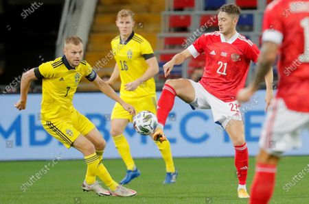 Sebastian Larsson (L) of Sweden in action against Anton Miranchuk (R) of Russia during the international friendly soccer match between Russia and Sweden at VTB Arena in Moscow, Russia, 08 October 2020.