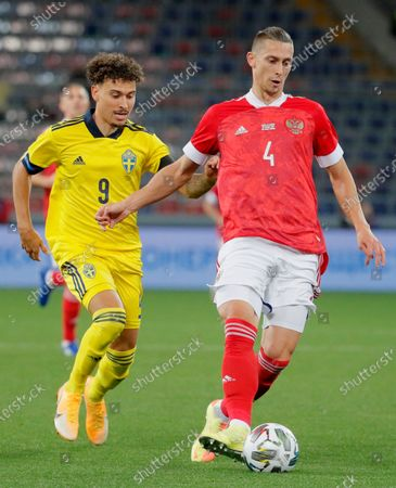 Jordan Larsson (L) of Sweden in action against Ilya Kutepov (R) of Russia during the international friendly soccer match between Russia and Sweden at VTB Arena in Moscow, Russia, 08 October 2020.