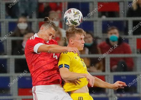 Emil Krafth (R) of Sweden in action against Ilya Kutepov (L) of Russia during the international friendly soccer match between Russia and Sweden at VTB Arena in Moscow, Russia, 08 October 2020.