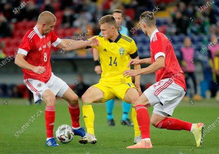 Mattias Svanberg (C) of Sweden in action against  Yuri Gazinski (L) and Ilya Kutepov (R) of Russia during the international friendly soccer match between Russia and Sweden at VTB Arena in Moscow, Russia, 08 October 2020.