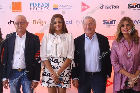 Founder of El Gouna Film Festival (GFF) Naguib Sawiris, GFF co-founder and foreign relations officer Bushra Rozza, Gouna resort owner Samih Sawiris, and Egyptian actress Yousra pose for a photo at a press conference on the preparations for El-Gouna Film Festival, in Cairo, Egypt, 08 October 2020. The fourth edition of GFF will take place from 23 to 31 October.