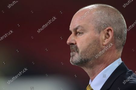 Scotland head coach Steve Clarke looks at the field ahead of the Euro 2020 playoff semifinal soccer match between Scotland and Israel, at the Hampden stadium in Glasgow, Scotland