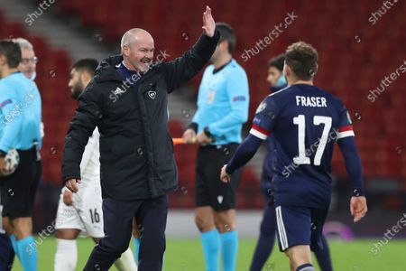 Scotland head coach Steve Clarke greets Scotland's Ryan Fraser after the Euro 2020 playoff semifinal soccer match between Scotland and Israel, at the Hampden stadium in Glasgow, Scotland