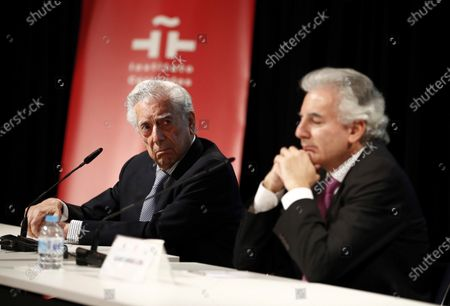 Peruvian writer Mario Vargas Llosa (L) and his son Alvaro Vargas Llosa (R) take part in a tribute on he occasion of the 10th anniversary of his Nobel award, held at Cervantes Institute in Madrid, central Spain, 08 October 2020.