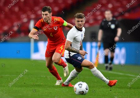 Wales' Ben Davies, left, dribbles past England's Kieran Trippier, right, during the international friendly soccer match between England and Wales at Wembley stadium in London