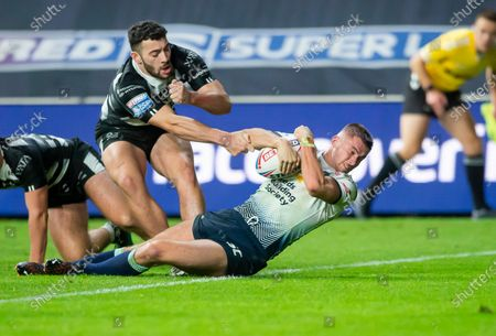 Hull FC's Jake Connor can't prevent Leeds's Jack Walker from scoring a try.