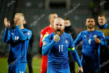 Iceland's captain Aron Gunnarsson, centre, celebrates with his teammates after the Euro 2020 playoff semifinal soccer match between Iceland and Romania in Reykjavik, Iceland