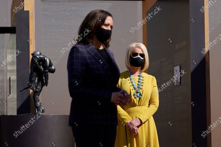 Stock Image of Vice presidential candidate Sen. Kamala Harris, D-Calif., and Cindy McCain listen as they visit the American Indian Veterans National Memorial with tribal leaders and veterans at Heard Museum in Phoenix