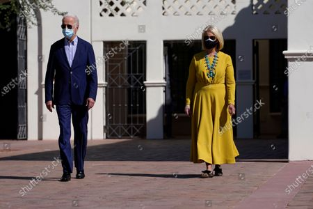 Stock Photo of Democratic presidential candidate former Vice President Joe Biden walks with Cindy McCain as they visit the Heard Museum in Phoenix