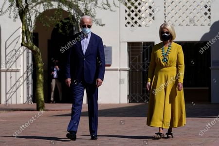 Democratic presidential candidate former Vice President Joe Biden walks with Cindy McCain as they visit the Heard Museum in Phoenix