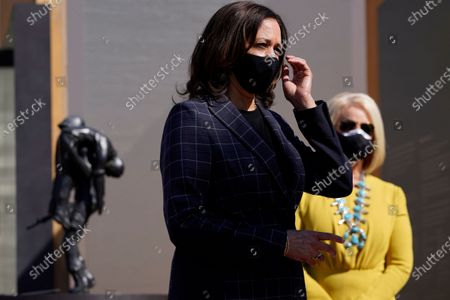 Vice presidential candidate Sen. Kamala Harris, D-Calif., and Cindy McCain listen as they visit the American Indian Veterans National Memorial with tribal leaders and veterans at Heard Museum in Phoenix