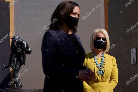 Stock Picture of Vice presidential candidate Sen. Kamala Harris, D-Calif., and Cindy McCain listen as they visit the American Indian Veterans National Memorial with tribal leaders and veterans at Heard Museum in Phoenix