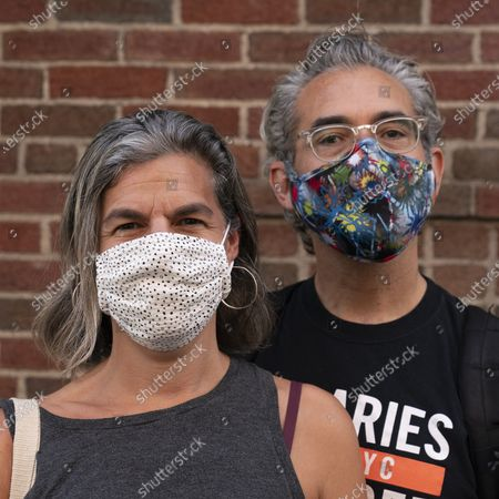 Leah Kramnick and Adam Lawrence pose with their masks, in New York