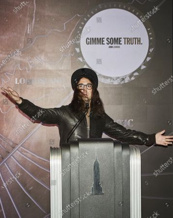 Sean Lennon stands with his arms out at the lighting ceremony of the Empire State building, in New York City