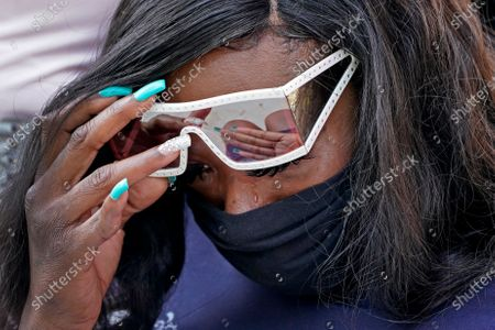 Stock Image of Deja Stallings wipes away tears during a news conference outside city hall, in Kansas City, Mo. Protesters have occupied the lawn and plaza in front of city hall more than a week demanding the resignation of police chief Rick Smith and the officer who knelt on Stallings' back while arresting the pregnant woman last week