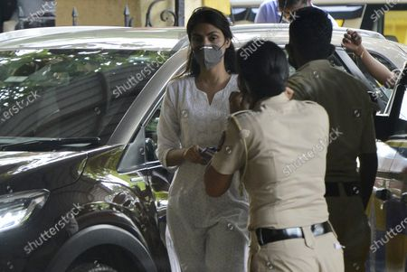 Stock Image of Bollywood actor Rhea Chakraborty arrives at Santacruz police station for attendance after Bombay high court granted bail in drugs-related charges in the Sushant Singh Rajput death case on Wednesday  on October 8, 2020 in Mumbai, India.
