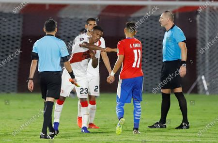 Paraguay's Angel Romero Villamayor (C, right) and Peru's Pedro Aquino Sanchez (C, left) greet each other after a South American qualifying match for the Qatar 2022 World Cup, at the Defensores del Chaco stadium in Asuncion, Paraguay, 08 October 2020.