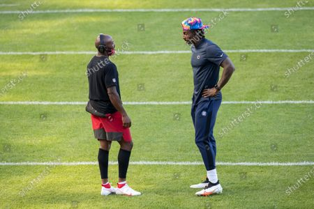 Chicago Bears wide receiver Javon Wims, right, chats with Tampa Bay Buccaneers wide receiver Cyril Grayson, left, before an NFL football game, in Chicago