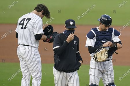 Stock Picture of New York Yankees starting pitcher Jordan Montgomery (47) puts on his cap after taking part in a mound conference with catcher Kyle Higashioka, right, and a translator, during the third inning in Game 4 of a baseball American League Division Series against the Tampa Bay Rays, in San Diego