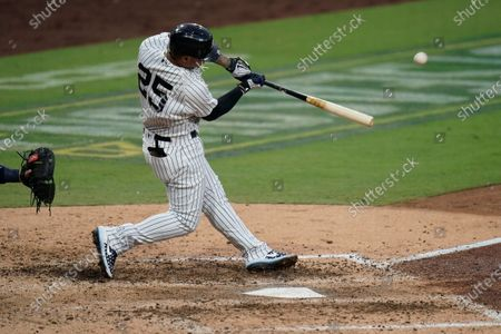 New York Yankees' Gleyber Torres hits a two-run home run against the Tampa Bay Rays to score Brett Gardner during the sixth inning in Game 4 of a baseball American League Division Series, in San Diego