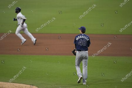 New York Yankees' Gleyber Torres, left, rounds the bases Tampa Bay Rays relief pitcher Ryan Yarbrough (48) watches after Torres hit a two-run home run during the sixth inning to score Brett Gardner in Game 4 of a baseball American League Division Series, in San Diego
