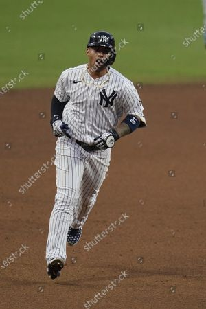 New York Yankees' Gleyber Torres reacts as he rounds the bases after hitting a two-run home run to score Brett Gardner during the sixth inning in Game 4 of a baseball American League Division Series against the Tampa Bay Rays, in San Diego