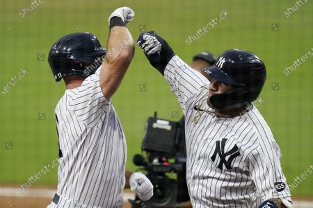 New York Yankees' Gleyber Torres, right, celebrates with Brett Gardner, left, after Torres hit a two-run home run to score Gardner during the sixth inning in Game 4 of a baseball American League Division Series against the Tampa Bay Rays, in San Diego