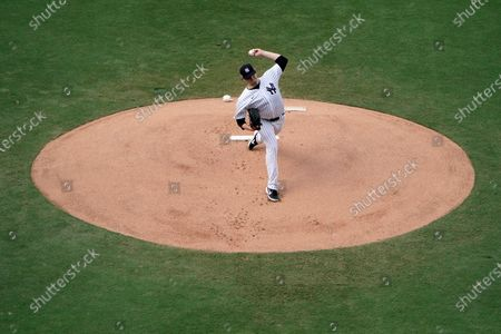 New York Yankees starting pitcher Jordan Montgomery throws against the Tampa Bay Rays during the first inning in Game 4 of a baseball American League Division Series, in San Diego