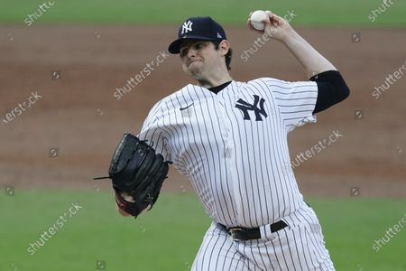 Stock Photo of New York Yankees starting pitcher Jordan Montgomery throws against the Tampa Bay Rays during the second inning in Game 4 of a baseball American League Division Series, in San Diego