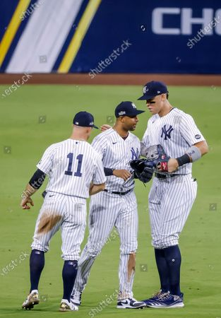 New York Yankees right fielder Aaron Judge (R) reacts with Yankees center fielder Aaron Hicks (C) and left fielder Brett Gardner (L) after the Yankees defeated the Tampa Bay Rays in the ninth inning of the American League Division Series playoff game four between the Tampa Bay Rays and the New York Yankees at Petco Park in San Diego, California, USA, 08 October 2020.
