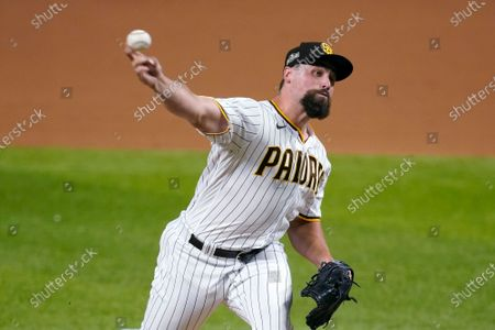 San Diego Padres' Greg Garcia delivers to the Los Angeles Dodgers during the fifth inning in Game 3 of a baseball National League Division Series, in Arlington, Texas