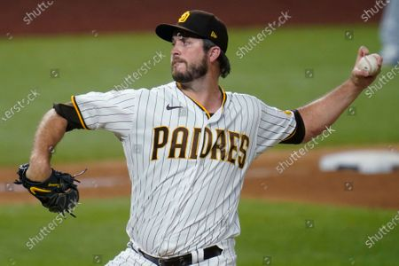 San Diego Padres' Drew Pomeranz delivers against the Los Angeles Dodgers during the seventh inning in Game 3 of a baseball National League Division Series, in Arlington, Texas