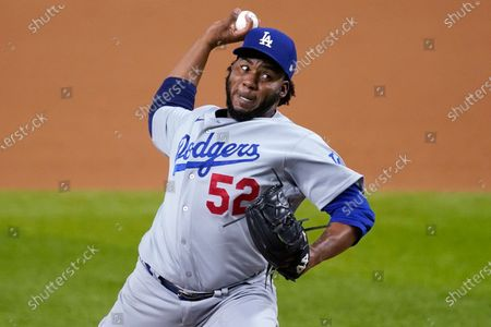 Los Angeles Dodgers pitcher Pedro Baez delivers against the San Diego Padres during the eighth inning in Game 3 of a baseball National League Division Series, in Arlington, Texas